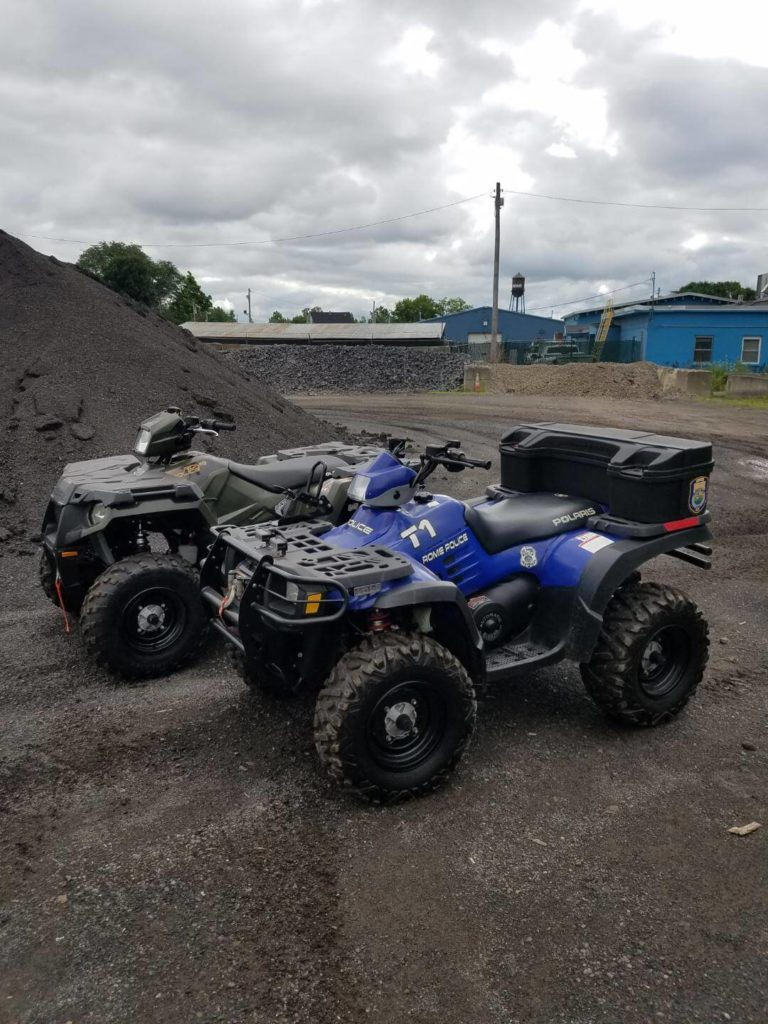empty rome police department ATVs in parking lot