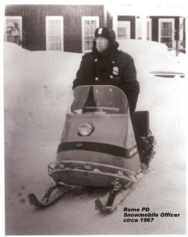 rome police department officer on snowmobile from 1967