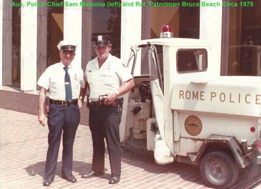 two rome police department officers chief sam madonia and patrolman bruce beach from 1975