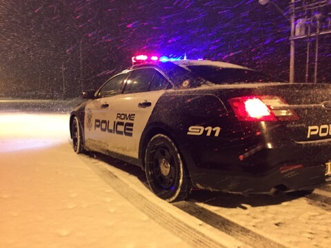 rome police department patrol vehicle in snow