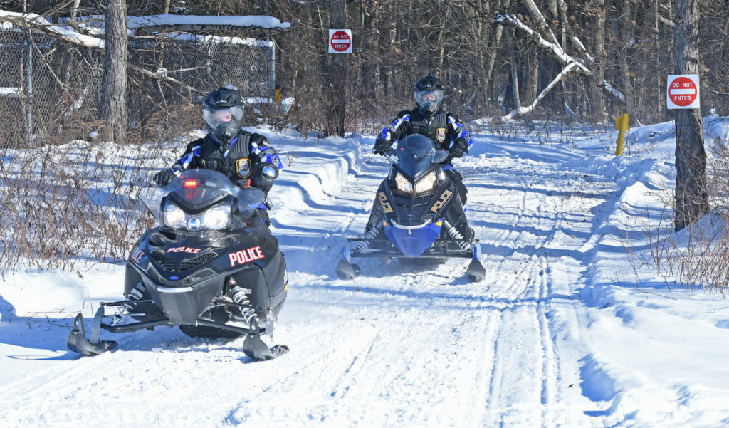 rome police department officers riding snowmobiles