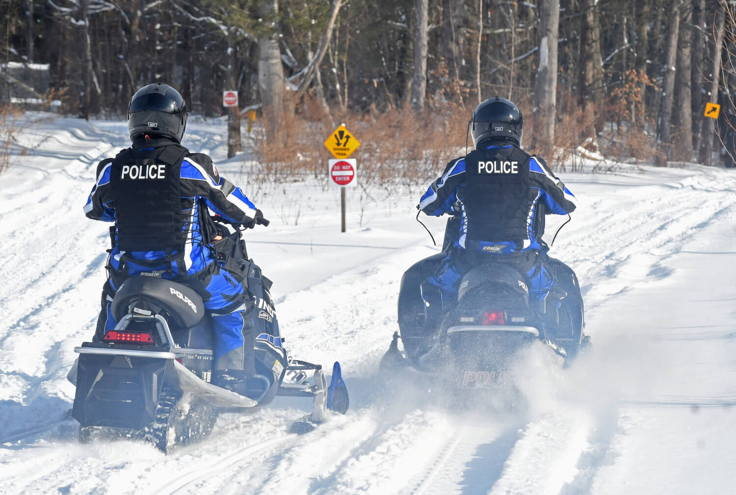 two all terrain unit officers for rome police department riding snowmobiles